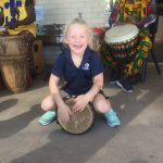 little-genesis-playing-bongo-drum